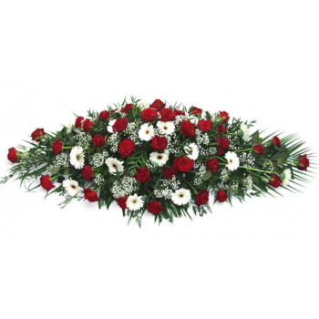 red roses and white casket spray